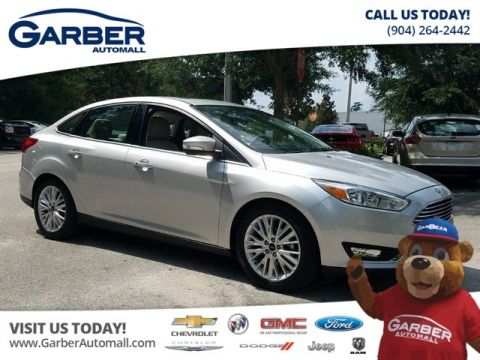PRE-OWNED 2017 FORD FOCUS TITANIUM W/NAVIGATION FWD SEDAN