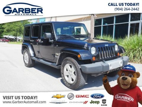PRE-OWNED 2010 JEEP WRANGLER UNLIMITED SAHARA 4WD